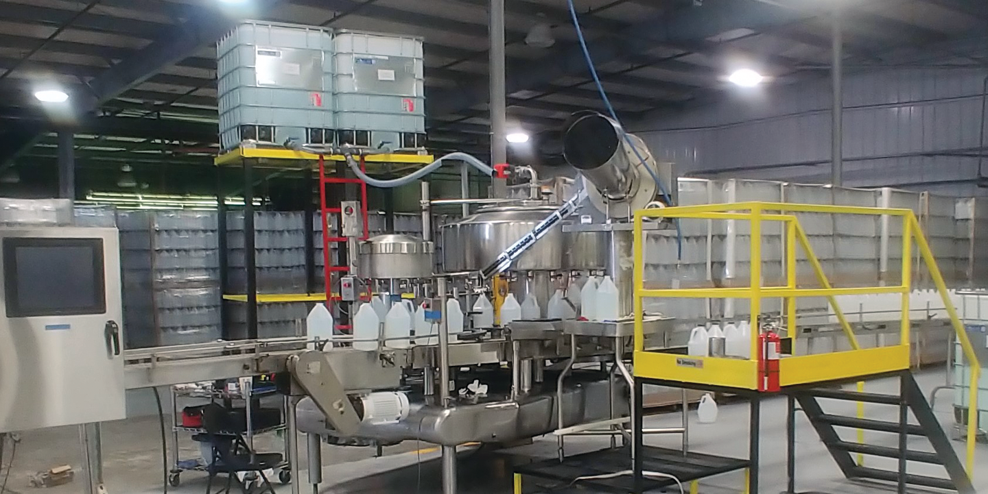 Shown here is the rotary filler/capper running on one of the five packaging lines that E66 now has running smoothly in its Oklahoma facility.